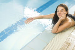 Young woman by the pool Royalty Free Stock Image