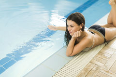 Young woman by the pool Royalty Free Stock Photography