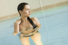 Young woman in the pool Royalty Free Stock Photography