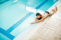 Young woman by the pool Stock Images