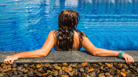 The young woman in the pool Royalty Free Stock Photos