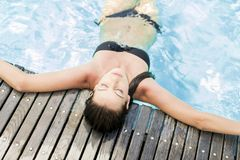 Young woman in the pool royalty free stock images