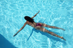Young woman in the pool. Royalty Free Stock Photography