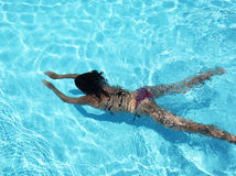 Young woman in the pool. Stock Image