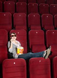 Young woman with popcorn in 3D movie Stock Image