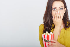 Young woman with popcorn Stock Image
