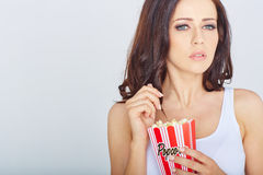Young woman with popcorn Stock Photo