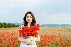 Young woman with poppies Stock Photography