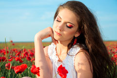 young woman in poppy field Stock Images