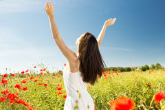 Young woman on poppy field Stock Image