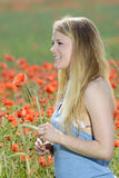 Young  Woman  in poppy field Stock Photo