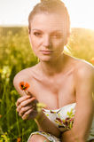 Young Woman poppy field at sunset Stock Photo