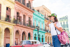 Young woman in popular area in old Havana, Cuba. Beautiful girl traveler background colorful houses in the city. Tourist girl in popular area in Havana, Cuba Royalty Free Stock Photos