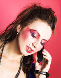 Young woman portrait. Portrait of pretty woman speaking by phone Royalty Free Stock Photo