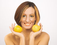 Young woman portrait. Portrait of young woman with orange and pear Stock Photos