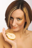 Young woman portrait. Portrait of young woman with pear in her hand Royalty Free Stock Image