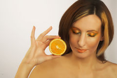 Young woman portrait. Portrait of young woman with oranges Royalty Free Stock Images