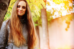 Young woman portrait in autumn color royalty free stock photography