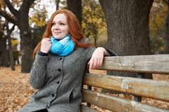 Young woman portrait in autumn park, yellow leaves and trees royalty free stock images