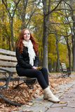 Young woman portrait in autumn park, yellow leaves and trees Royalty Free Stock Photos