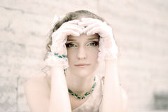 Young woman portrait. Beautiful girl in white gloves Stock Photo