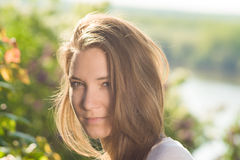 Young woman portrait with beautiful hair outdoor smiling Royalty Free Stock Photography
