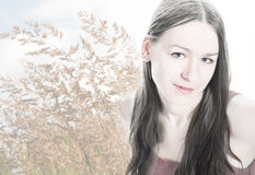 Young woman portrait on bent grass background Royalty Free Stock Images