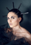 Young woman portrait with black spikes. Woman portrait with black spikes royalty free stock photos