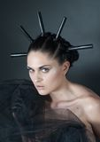 Young woman portrait with black spikes. Woman portrait with black spikes in hair stock image