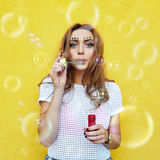 Young woman portrait blowing soap bubbles Royalty Free Stock Image