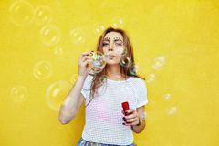 Young woman portrait blowing soap bubbles Stock Image
