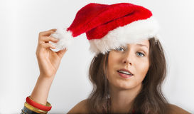 Young woman portrait with a Christmas cap Stock Images