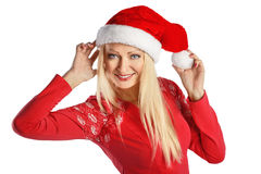 Young woman portrait in Christmas Santa hat isolated. Royalty Free Stock Images