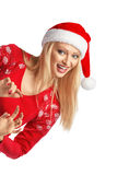 Young woman portrait in Christmas Santa hat isolated. Royalty Free Stock Image