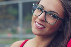 Young beautiful women closeup eyeglasses red dress elegant style attractive girl beauty lady Stock Photos