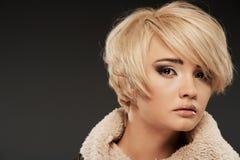 Young woman portrait. Closeup beauty studio shoot. Royalty Free Stock Photography