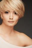 Young woman portrait. Closeup beauty studio shoot. Stock Images