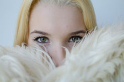 Young Woman portrait with fur coat Royalty Free Stock Photography