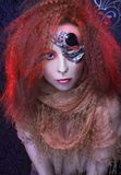 Young woman. Portrait of young ginger woman with artistic visage royalty free stock photography