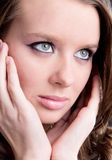 Young woman portrait with hands Stock Image