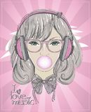 Young woman portrait with headphones, chewing gum Royalty Free Stock Photos