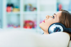 Young woman portrait with headphones music listeni Stock Image