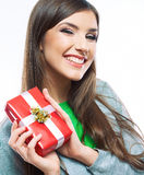 Young woman portrait hold gift in christmas color style . Smili Stock Photo