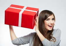 Young woman portrait hold gift in christmas color style Stock Image