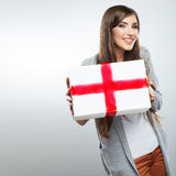 Young woman portrait hold gift in christmas color style Royalty Free Stock Photo