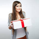 Young woman portrait hold gift in christmas color style Royalty Free Stock Photography