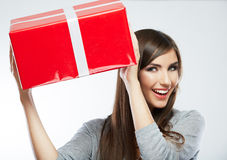 Young woman portrait hold gift in christmas color style Stock Images