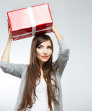 Young woman portrait hold gift in christmas color style Royalty Free Stock Image