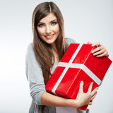 Young woman portrait hold gift in christmas color style Royalty Free Stock Images