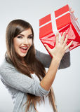 Young woman portrait hold gift in christmas color  Stock Photo